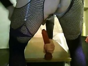 Crosdresser slut rides on rubber dildo
